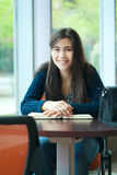 Happy young college student studying at school Stock Photo