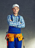 Happy young construction worker Stock Images