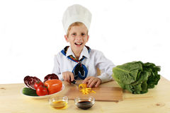 Happy young cook Stock Image