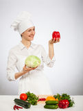 Happy young cook holding head of savoy cabbage Royalty Free Stock Images