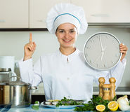 Happy young cook preparing tasty fish for dinner Royalty Free Stock Image