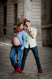 Happy young cool  latin couple together outdoors with pregnant woman showing belly Royalty Free Stock Image