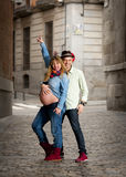 Happy young cool  latin couple together outdoors with pregnant woman showing belly Stock Images