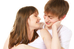 Happy young couple. Laughing young couple on white background Stock Images