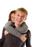Happy young couple. Laughing and embracing against a white background Royalty Free Stock Photos