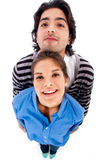 Happy young couple. On isolated background royalty free stock photography