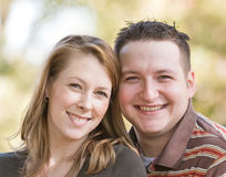 Happy Young Couple. Close up of a Happy Young Couple Smiling Stock Images