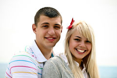 Happy young couple. Smiling on the beach stock photo