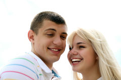 Happy young couple. Smiling on the beach stock images