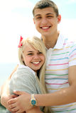 Happy young couple. Smiling on the beach stock photos