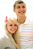 Happy young couple. Smiling on the beach royalty free stock photo