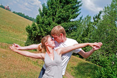 Happy young couple. Happy couple looking to each other, wakling on the countryside Stock Photos