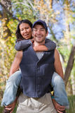 Happy young couple. In fall forest. Shallow DOF, focus on guy Royalty Free Stock Photography