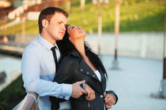 Happy young fashion couple in love outdoor Stock Images