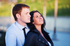 Happy young couple in love. Happy young couple on the city street Royalty Free Stock Photo
