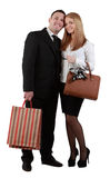 Happy young couple. With shopping bags posing in a studio against a white background Royalty Free Stock Photos