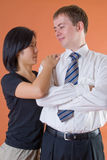 Happy young couple. A happy young multi-racial couple from Europe and Japan stand together royalty free stock image