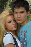 Happy young couple. Portrait of attractive teenage couple in park stock photography