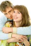 Happy young couple. Young man and woman embrace and laugh Stock Photography