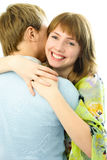 Happy young couple. Young man and woman embrace against white background Royalty Free Stock Image