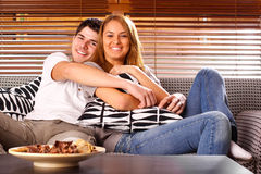 Happy Young Couple. Having fun on the sofa stock photography