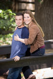 Happy young couple. Closeup of happy young couple embracing outdoors Royalty Free Stock Photos