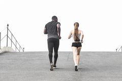 Happy young couple afro-american man and european woman running together. A loving couple is run, engaged in sports stock photo