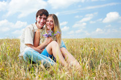 Happy young couple against blue sky Stock Photography
