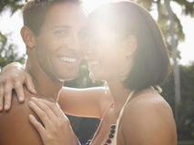 Happy Young Couple With Arms Around Stock Image