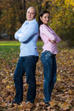 Happy Young Couple With Arms Crossed Royalty Free Stock Photo