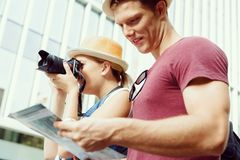 That will be a great picture. Happy young couple as tourists with a camera Stock Image