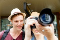 That will be a great picture. Happy young couple as tourists with a camera Stock Photo
