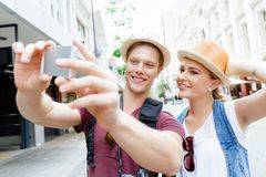 That will be a great picture. Happy young couple as tourists with a camera Royalty Free Stock Photo