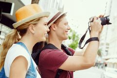That will be a great picture. Happy young couple as tourists with a camera Stock Photography