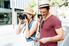 That will be a great picture. Happy young couple as tourists with a camera Royalty Free Stock Photography
