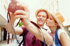 That will be a great picture. Happy young couple as tourists with a camera Royalty Free Stock Photos