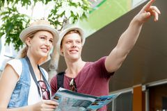 New places to explore. Happy young couple as tourists with a map Stock Image