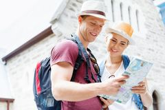 New places to explore. Happy young couple as tourists with a map Stock Photography