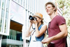 New places to explore. Happy young couple as tourists with a map Royalty Free Stock Photo