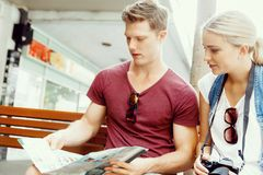 New places to explore. Happy young couple as tourists with a map Stock Photos