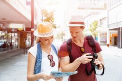 New places to explore. Happy young couple as tourists with a map Royalty Free Stock Photos