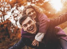 Happy Young Couple on Autumn. Bottom view. Beautiful White Woman. Handsome Man in Park. Outdoor. Lovestory of Two. Romance in the Park. Love Lifestyle. Happy stock photography