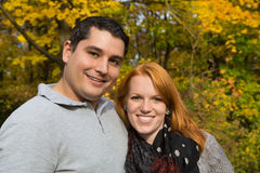 Happy young couple in autumn making a walk on the fresh air. royalty free stock images
