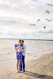 Happy young couple with baby girl standing in water Stock Images