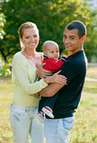 Happy young couple with baby son in pa Royalty Free Stock Image