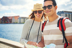 Happy young couple on a backpacking holiday royalty free stock photography