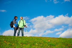 Happy young couple with backpacks Royalty Free Stock Image