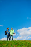 Happy young couple with backpacks Royalty Free Stock Photos