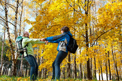 Happy young couple with backpacks in the park Stock Photos