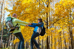 Happy young couple with backpacks in the park Royalty Free Stock Image